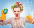 Funny housewife with scubberr cleaning window / glass . Foam / soap on glass
