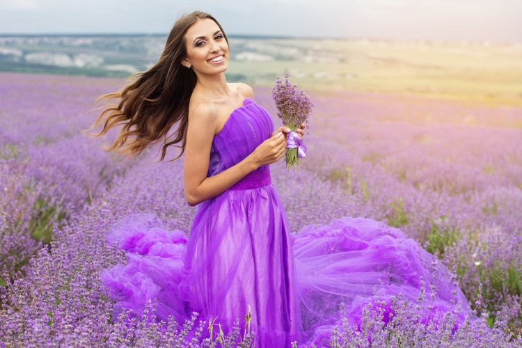 Woman with flying long hair at lavender fields